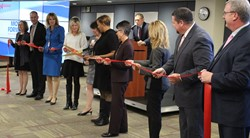 Ribboncutting ceremony with component district superintendents.