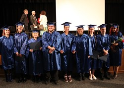 Photo of the smiling graduates.