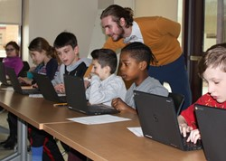 Guest presenter Gabriel Schickling with students at workshop.
