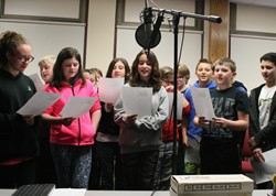 Group of students singing.