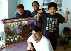 Three of the students with instructor and semi-completed vivarium.