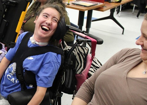 BOCES student laughing with her aide.