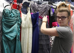 Young woman shopping for prom dresses at the Clothing Closet.