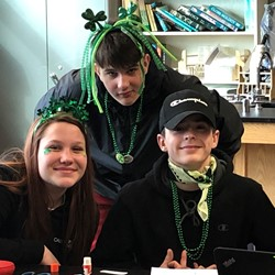 Three students wearing green.