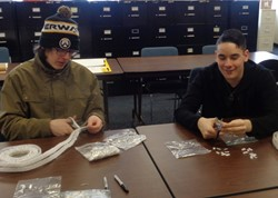 Students worked together, patiently cutting Velcro strips for specialists to use when creating their schedules.