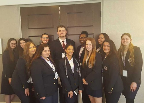 Group shot of 12 HOSA Conference competitors.