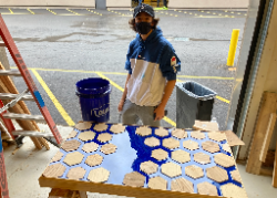 Senior Brian Benedetto (Churchville-Chili) used scrap lumber to make a geometric epoxy table.