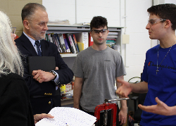 Two students explaining the CTE program to two visitors