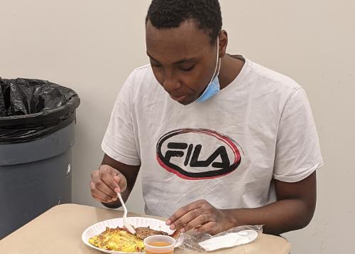 Christopher enjoying his breakfast
