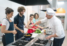 Culinary students cooking with a chef
