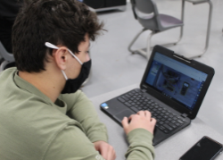 Student learning on a laptop