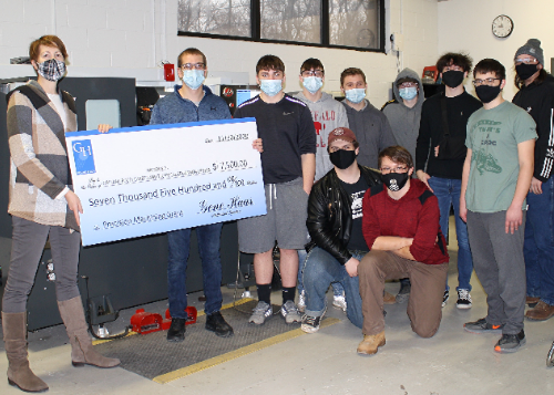 CTE staff and students holding large check for donation