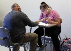 Westview teacher Tim Baker helps a student navigate a challenging assignment