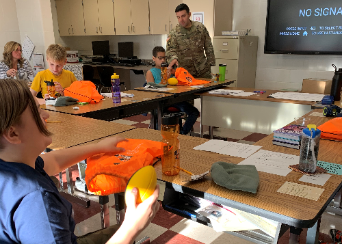 Students check out some of the ROTC gear Crosby brought for them