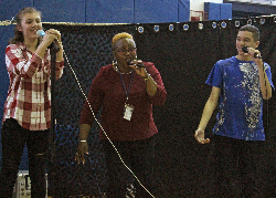 Three vocalists: part of a group of six singers.