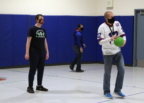 Teacher and students playing dodgeball