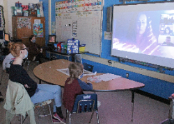 Students watching readers on large screen