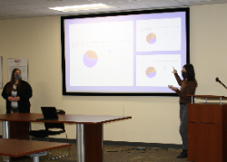 Two students giving a public policy presentation