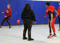 Students playing kickball in the gym