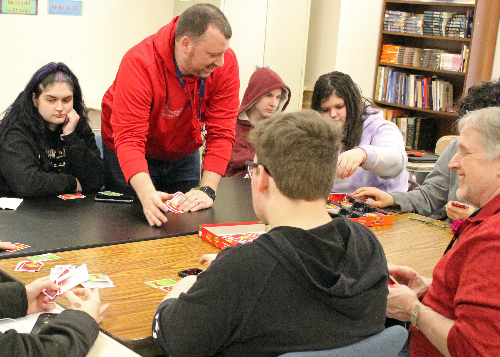 Teachers and students playing Apples to Apples: a card game that builds vocabulary