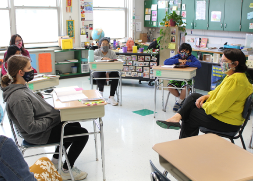 Guest author speaking with students