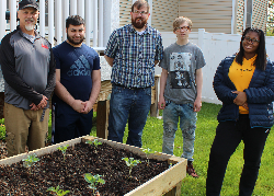 AHS teachers and students with garden box and plants.