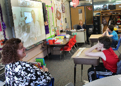 Students participating in an interactive video conference.