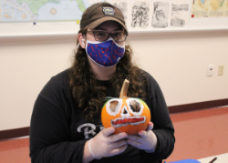 Student with pumpkin