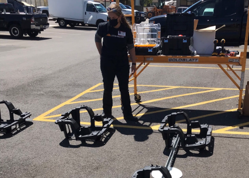 Trainer Sue Stark with donated solar equipment in the WEMOCO parking lot