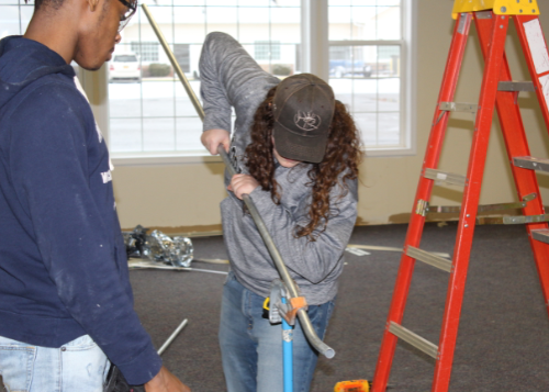 Residential and Commercial Electrical students help with renovation