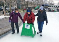 Three friends ice skating