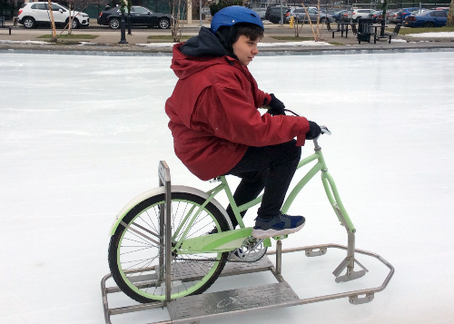 Student riding special ice bike
