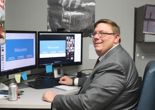 Jim Belair sitting in office