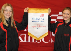 Two students holding award banner