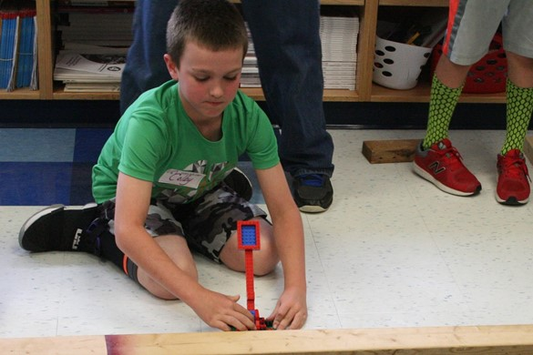 Student using a catapult.