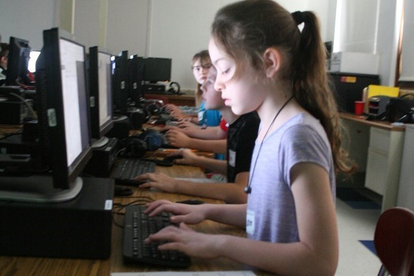 Student at a computer learning coding.