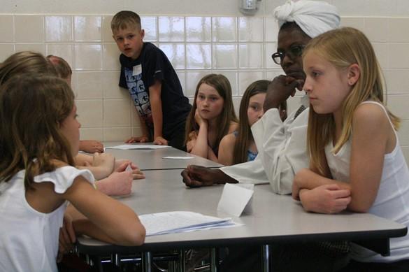 Students talking with Harriet Tubman re-enactor.