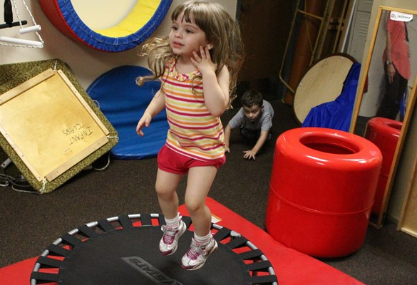 Preschool student on trampoline.