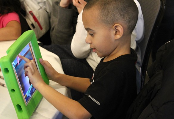 Child using assistive technology.