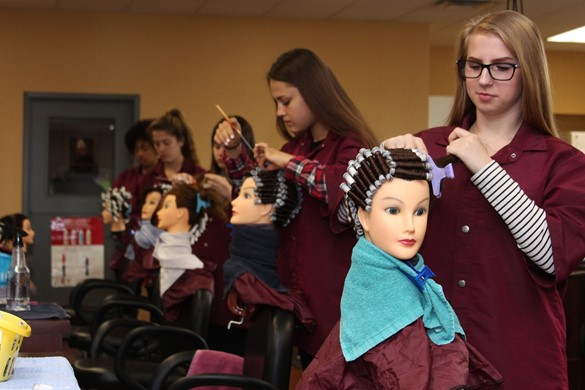 cosmetology students working on mannequins