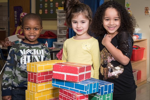 Three children in Integrated PreK program with blocks.
