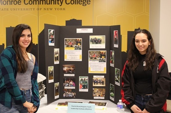 Puerto Rican/Hispanic Youth Leadership display with students.