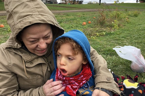 Medically fragile student and aide visiting a pumpkin farm