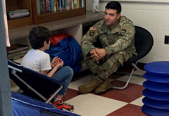 Visiting army major speaks with a student