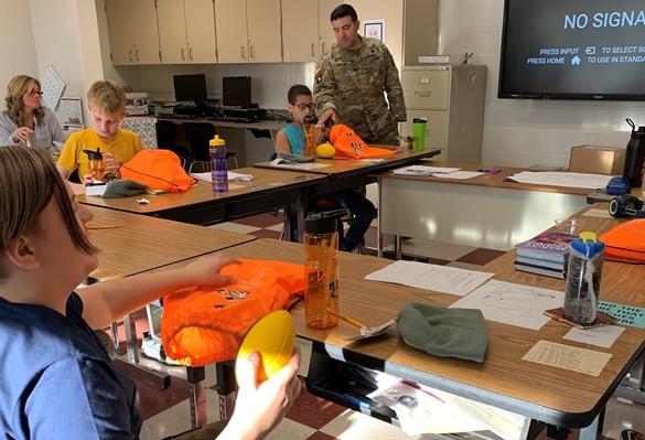 Visiting army major visits a classroom