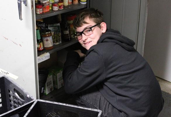 Student volunteer at Cameron Street Ministries Emergency Food Pantry
