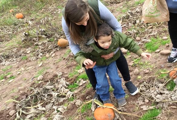 Student in a pumpkin field
