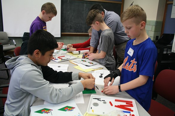 Group of students working with gears.