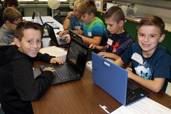 Students learning coding in Project Adept class