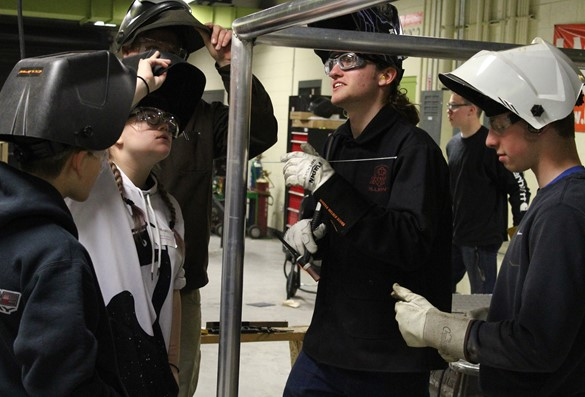 CTE Student Ambassadors demonstrating welding to visiting eighth-graders.